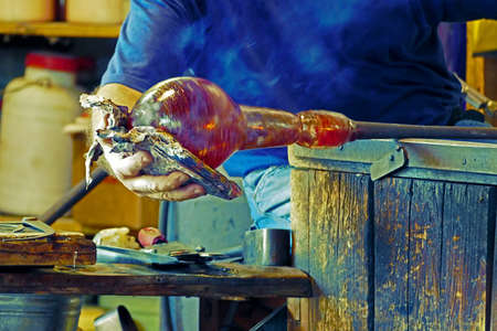 public demonstration: Glass worker in action (public demonstration) in the Murano, Italy, glass factory