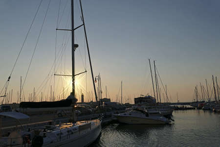 smaller: TRIESTE, ITALY - AUGUST 6, 2015 : Sunset in the nautical smaller boats port. Trieste, Italy. Editorial