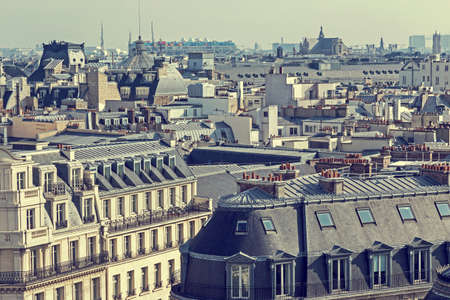 parisian scene: Old photo with aerial view, from Eiffel tower. Roofs in Paris, France. Vintage processing.