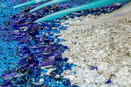 Murano: White and blue background with pieces of Murano glass.