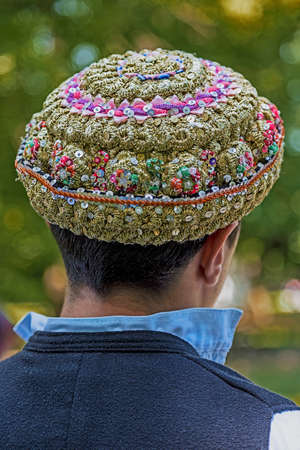 bulgarian ethnicity: Hats traditional Bulgarian male, embroidered with popular models and placed on a mans head. Stock Photo