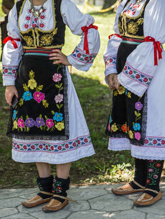 attended: Young girls from Serbia, in traditional specific costumes, attended at a international folk dance festival