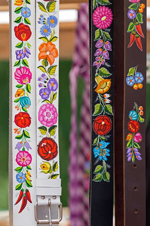 embroidered: Belts for women, painted and embroidered with hungarian traditional patterns. Stock Photo