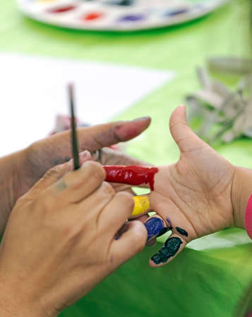 kids painted hands: Background with kids painted hands. Happy childhood.
