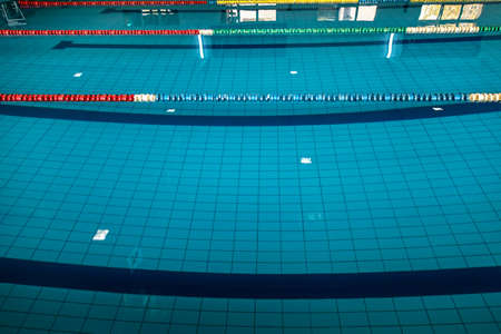 Background with a swimming pool and markers between lanes competition.
