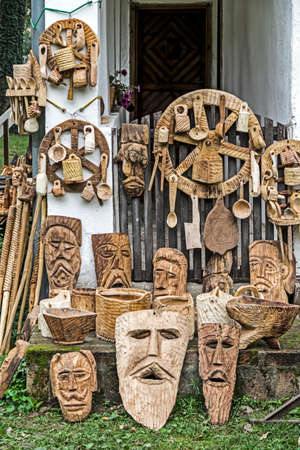 design objects: TIMISOARA, ROMANIA - SEPTEMBER 20, 2014; Decorative wooden carved, traditional Romanian, and exposed for sale.