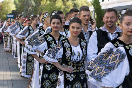 traditional: ROMANIA, TIMISOARA - JULY 7, 2016:Young people from Romania in traditional costume, present at the international folk festival, International Festival of hearts organized by the City Hall Timisoara. Editorial