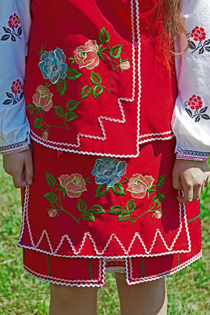 Detail of Ukrainian folk woman costume with multi colored embroidery.