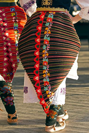 Young girls from Serbia, in traditional specific costumes, at a folk dance festival. Stock Photo