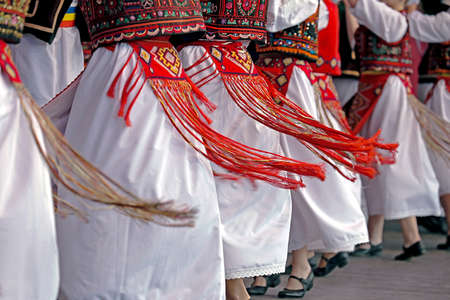 traditional: Romanian dancers in traditional costume, perform a folk dance. Stock Photo
