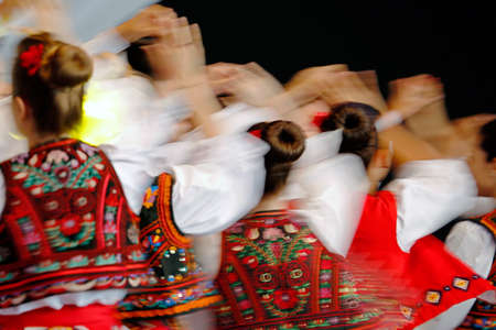 an entertainer: Abstract blur moving with amazing dance. Young Romanian dancers in traditional costume.