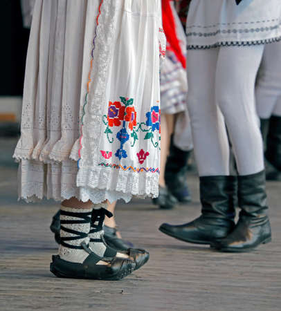 popular: Feet of dancers and clothes in traditional Romania folk dances. Stock Photo