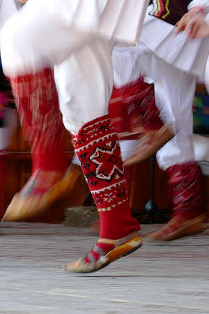 an entertainer: Abstract motion feet of dancers with traditional bulgarian folk dances.