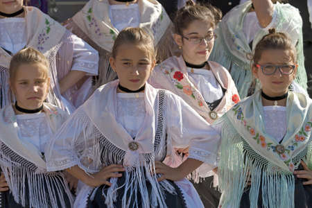 german ethnicity: ROMANIA,TIMISOARA-JULY 7, 2016:Young girls from Romania in traditional german costume,present at the international folk festival International Festival of hearts organized by the City Hall Timisoara