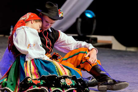 show folk: ROMANIA,TIMISOARA-JULY 7,2016:Young Polish dancers in traditional costume perform in one show at the international folk festival International Festival of hearts organized by the City Hall Timisoara