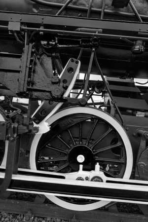 b w: Old german steam locomotive, built in 1940, in a museum. The heaviest locomotive, 85 tons, that circulated in Romania during the Second World War. Detail and close up of huge wheels. B & W processing.