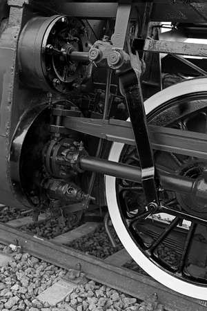 b w: Old german steam locomotive, built in 1940, in . The heaviest locomotive, 85 tons, that circulated in Romania during the Second World War. Detail and close up of huge wheels. B & W processing.
