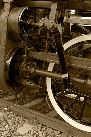 circulated: Old german steam locomotive, built in 1940, in a museum. The heaviest locomotive, 85 tons, that circulated in Romania during the Second World War. Detail and close up of huge wheels. Sepia processing.