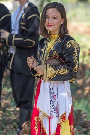 ROMANIA, TIMISOARA - JULY 10, 2016: Young girl from Turkey in traditional costume, present at the international folk festival  International Festival of hearts  organized by the City Hall Timisoara.