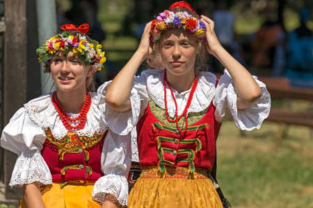 ROMANIA, TIMISOARA - JULY 10, 2016: Young girls from Poland in traditional costume, present at the international folk festival, International Festival of hearts organized by the City Hall Timisoara.
