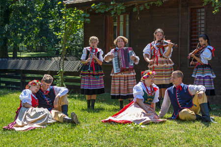 show folk: ROMANIA,TIMISOARA-JULY 10,2016:Young Polish dancers in traditional costume perform in one show at the international folk festival International Festival of hearts organized by the City Hall Timisoara