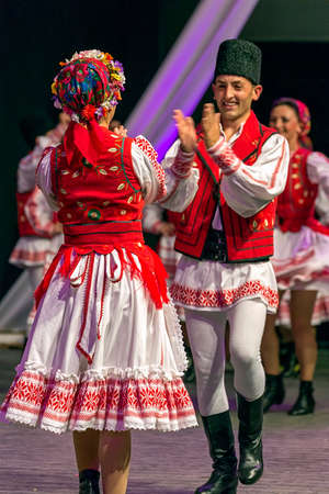ROMANIA, TIMISOARA - JULY 7, 2016: Young Romanian dancers in traditional costume, perform folk dance during International Festival of hearts , organized by the City Hall Timisoara.