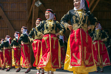 ROMANIA, TIMISOARA - JULY 10, 2016: Young Turkish dancers in traditional costume, present at the international folk festival, International Festival of hearts organized by the City Hall Timisoara. Редакционное