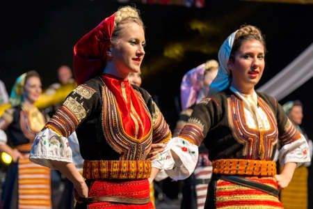 """ROMANIA, TIMISOARA - JULY 8, 2016: Young Serbian dancers in traditional costume, present at the international folk festival, """"International Festival of hearts"""" organized by the City Hall Timisoara. Sajtókép"""