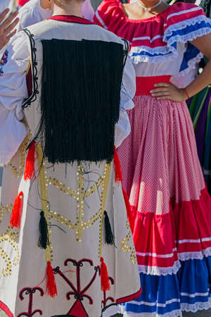 costa rican: Detail of Serbian and Costa Rican folk costume for women, with multicolored embroidery.