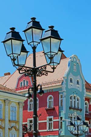 historic buildings: Historic buildings and street lamp in Union Square, Timisoara, Romania.