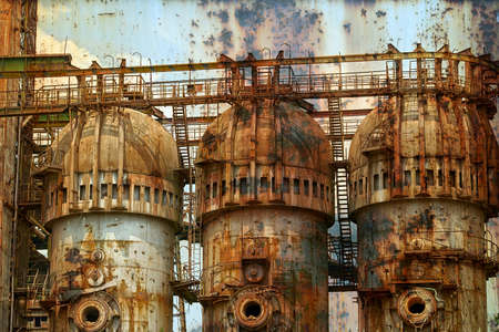 steelwork: Rusty background with old steel furnace from Resita city, Romania. Vintage processed.