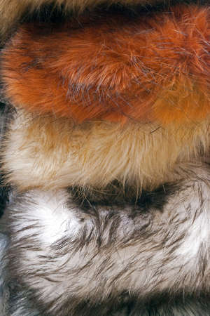 overlapping: Background and texture of overlapping fur hats. Stock Photo