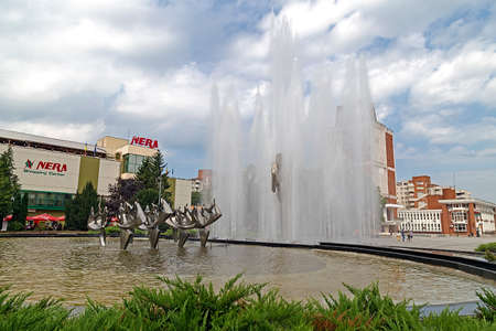 constantin: RESITA, ROMANIA - JUNE 20, 2016: Kinetic fountain located in the central square of Resita. Creation of sculptor Constantin Lucaci, was inaugurated on 23 August 1984.
