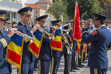 fanfare: TIMISOARA, ROMANIA - SEPTEMBER 25, 2016: Military fanfare playing at trumpet with occasion of ,,Festival of fanfares organized by the Timisoara City Hall.
