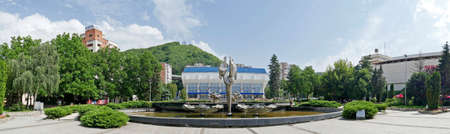 constantin: RESITA, ROMANIA - JUNE 20, 2016: Panoramic view with Kinetic fountain located in the central square of Resita and sports hall. Creation of sculptor Constantin Lucaci, was inaugurated on 23 August 1984