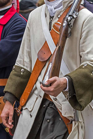 musket: Background of a medieval soldier with musket that marching on the street.