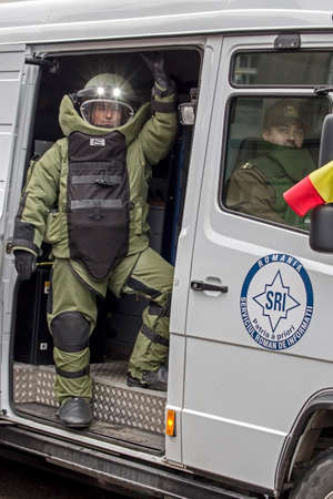 subversion: TIMISOARA, ROMANIA - DECEMBER 1, 2016: Military parade at Romanian National Day. Cop from bomb squad simulating a mission. Picture taken in front of the Administrative Palace in Timisoara.