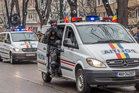 subversion: TIMISOARA, ROMANIA - DECEMBER 1, 2016: Military parade at Romanian National Day. Cops simulating a mission. Picture is taken in front of the Administrative Palace in Timisoara. Editorial