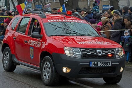 TIMISOARA, ROMANIA - DECEMBER 1, 2016: Military parade at Romanian National Day. Fire mans simulating a mission. Picture taken in front of the Administrative Palace in Timisoara. Editorial