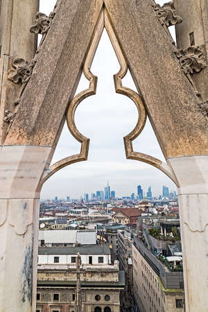 MILAN, ITALY - DECEMBER 11, 2016: View over Milan from the top of the gothic cathedral Duomo di Milano (Milan Cathedral), Italy. Skyscrapers of the city in the background.