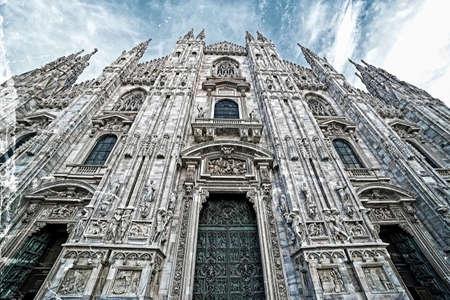 Old photo with facade of the famous Milan Cathedral, Lombardy, Italy. Vintage processing. Stock Photo