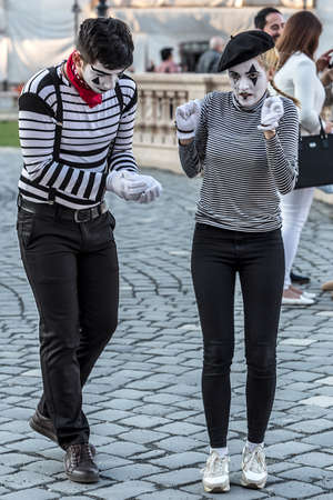 mummery: TIMISOARA, ROMANIA - MARCH 31, 2017: Pantomime couple with painted face, present on the street inside the CheckART Carnival organized by the City Hall Timisoara. Union Square. Editorial
