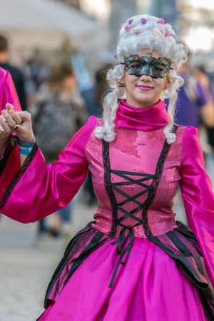 processions: TIMISOARA, ROMANIA - MARCH 31, 2017: Woman on the street dressed in period costumes and present on the street inside the CheckART Carnival organized by the City Hall Timisoara.