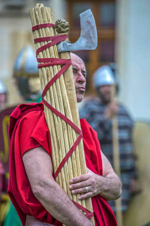 ALBA IULIA, ROMANIA - APRIL 29, 2017: Carrier of Roman antic symbols in one demonstration at APULUM ROMAN FESTIVAL, organized by the City Hall. Editorial