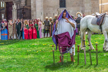 ALBA IULIA, ROMANIA - APRIL 29, 2017: Priest Roman praying in ancient costum and rituals in one demonstration at APULUM ROMAN FESTIVAL, organized by the City Hall. Editorial