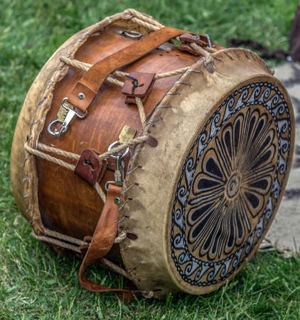 specific: Ancient Dacian wooden and leather drum with decorations, used in battles.