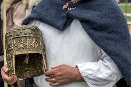 Dacian combat helmet and specific textile coat at an antique arms exhibition. 版權商用圖片