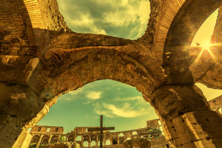 ROME, ITALY - MAY 30, 2017: Sunset and fish eye view inside the Colosseum, Rome, Italy, with specific ruins and sky with clouds in background.