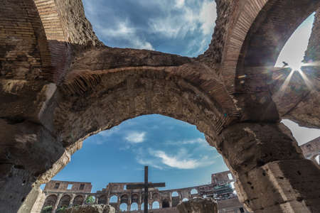 ROME, ITALY - MAY 30, 2017: Sunshine and fish eye view inside the Colosseum, Rome, Italy, with specific ruins and sky with clouds in background.