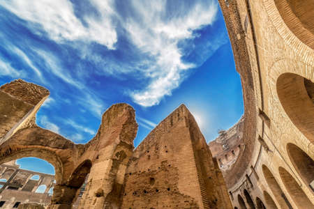 ROME, ITALY - MAY 30, 2017: Fisheye view inside the Colosseum, Rome, Italy, with specific ruins and sky with clouds in background.